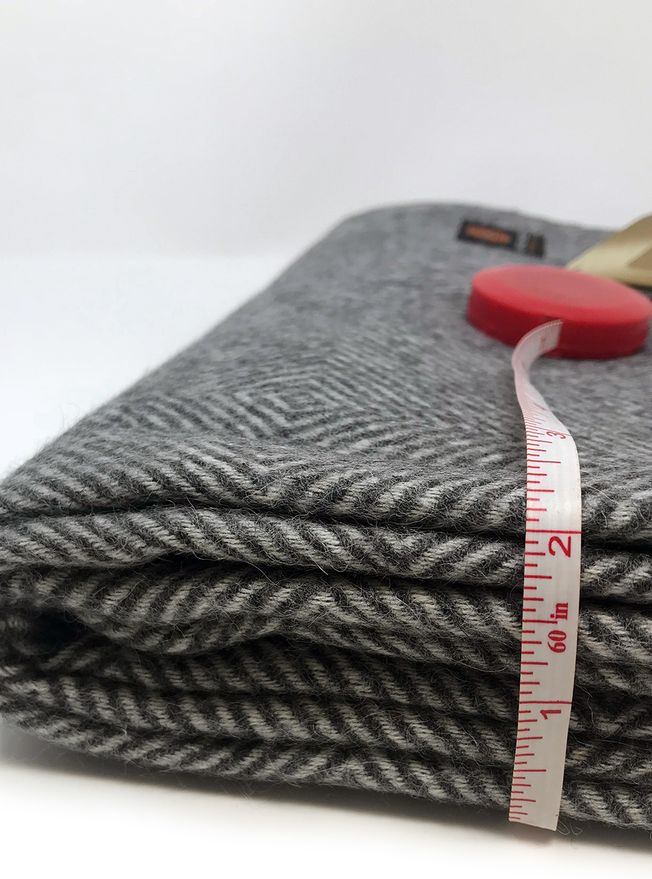 Baby Alpaca Monopoly Throw Short line - showing thickness
