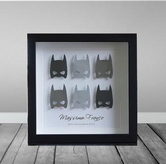 Superhero Batmam paper art in black frame