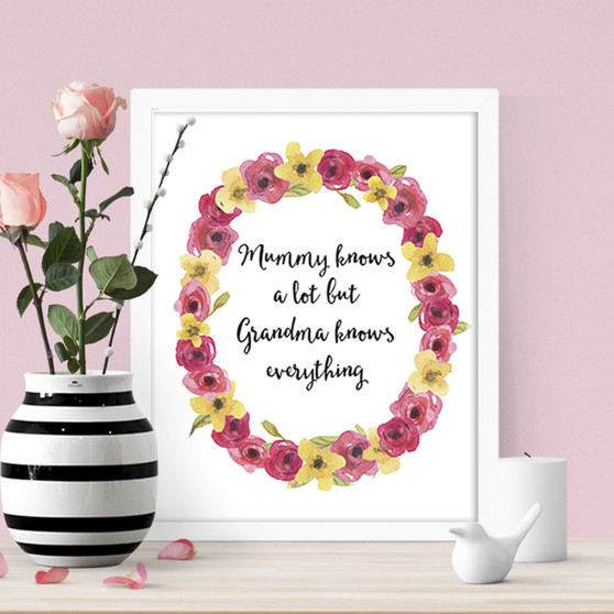 Grandma knows everything print in optional white timber frame
