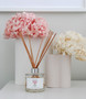 Marmoset Found - Ribbed Infinity Vase Nude (S), shown with Marmoset Found - Ribbed Infinity Vase Snow (M) and Peony Luxury Fragrance Diffuser