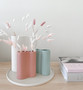 Marmoset Found - Smooth Infinity Vase - Ochre (S), styled with Smooth Infinity Vase - White (M), Smooth Infinity Vase - Blue (S) and Cloud Round Platter Chalk White (L)