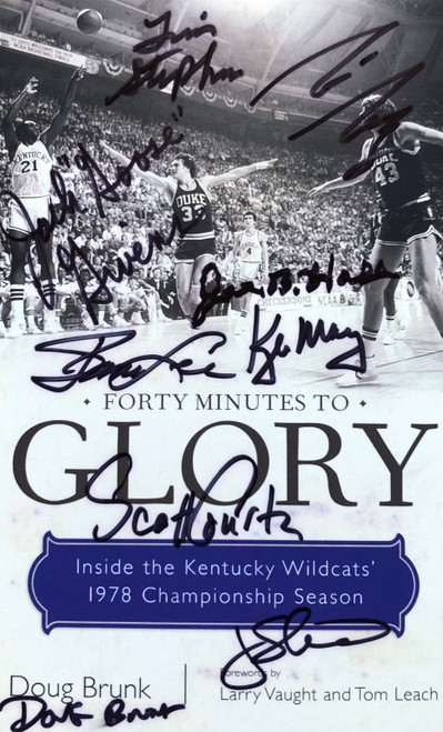 """Return to Glory"" book is signed by team members, Coaches, and managers on the front and back cover."