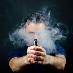 Man Holding a Vape Mod Surrounded by Vapour