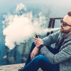 man vaping 100% VG e-liquid