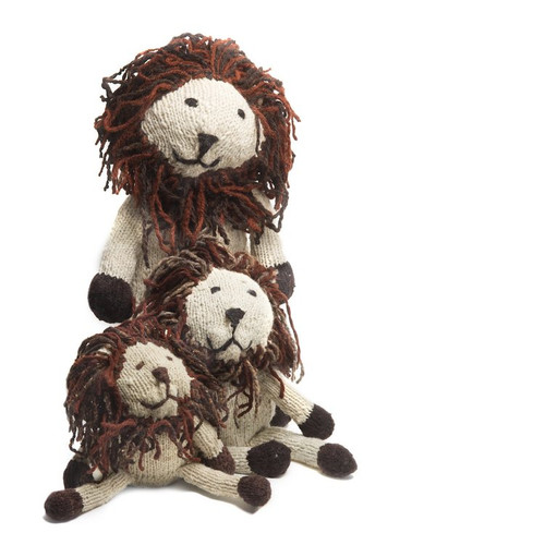 three hand knitted lions made of wool sitting together