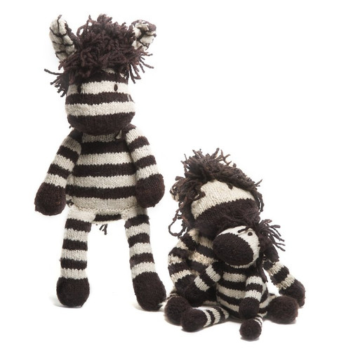 Three hand knitted woollen zebras sitting together