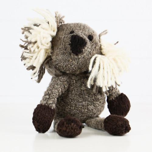 Hand Knitted Australian knitted koala sitting.