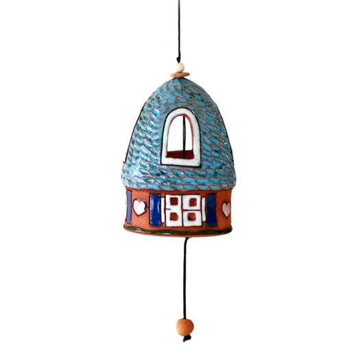 A glazed ceramic house bell with a round textured roof. Strung with nylon cord & ceramic beads. The word KOVAS means rook in Lithuanian.  Size: approx. 8.5 x 6 cm bell, 33 cm height including string Weight: approx. 80 g