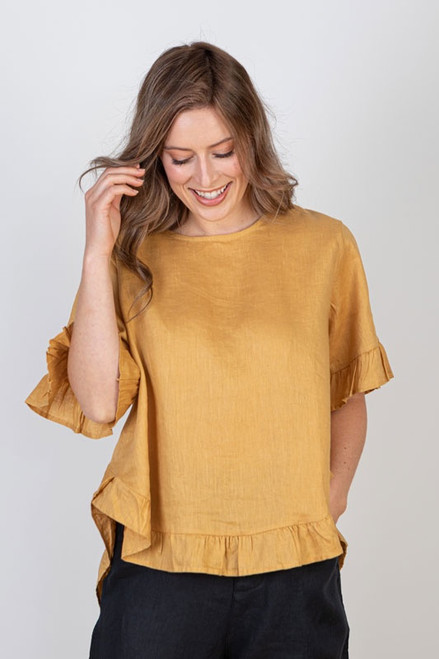 Linen, relaxed fit top in mustard with ruffle detail.