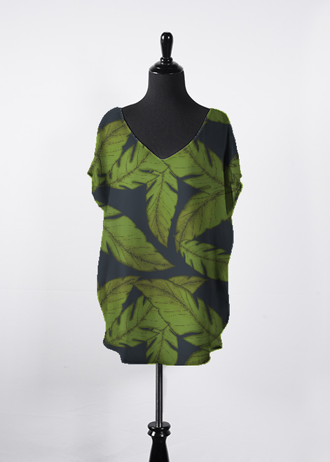 Jungle Paradise print top sitting on model