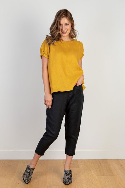 Black Linen pencil pants worn with mustard yellow top. Jj Sisters Melbourne
