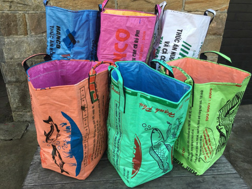 a group of colourful laundry hampers made from old cement bags in Cambodia
