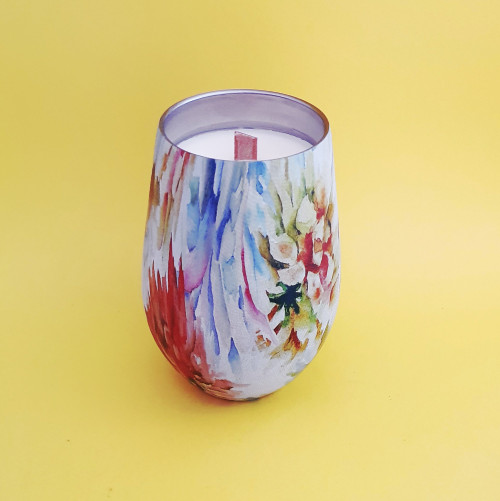 colourful reusable coffee cup with candle inside. Repurpose after use.