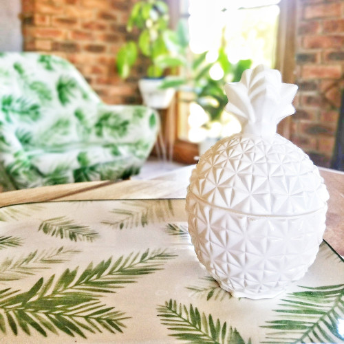 simple retreat pineapple candle in white pineapple shaped jar.