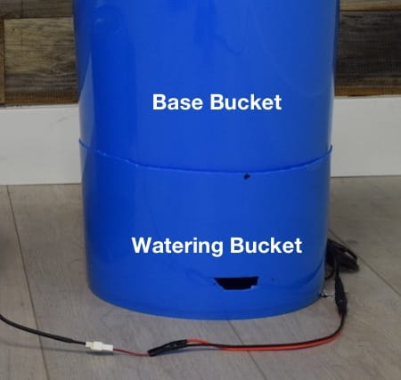 Place the bottom bucket on top of the bucket stand in the water reservoir bucket.