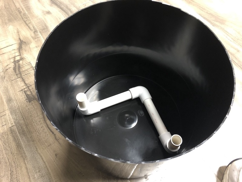Place pvc bucket stand into the water reservoir bucket