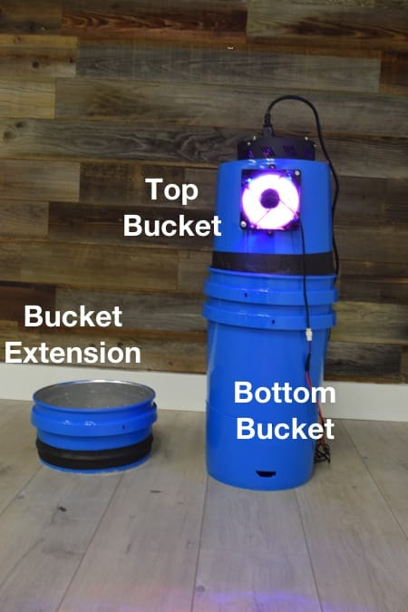 Fit the top bucket into the base bucket.