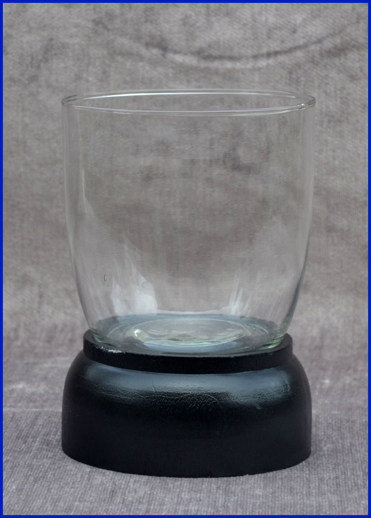 glass-candle-holder-with-wooden-base-656082.jpg