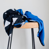 Child swaddle white triangles on black backing is royal blue Cairo