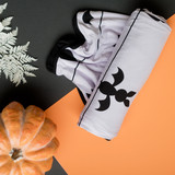 You make me batty.  Flat lay photo of our purple and black Halloween adult swaddle blanket