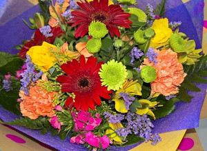 A beautiful bouquet, in bright & colourful hues.  The picture shown is an example and the flower types may vary but the colour arrangement will always be bright and cherry!  Sure to make someone smile:)