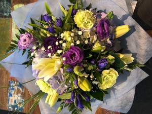 A pretty mix of flowers including purple and blue hues.