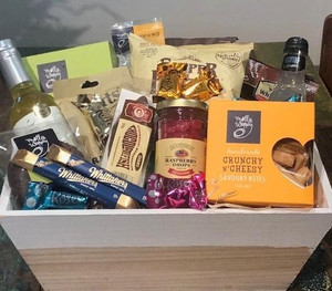 A delicious assortment of fine foods and treats, presented in a white gift box.  Available in small, medium, large and extra large