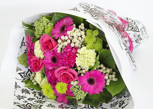 A bouquet of flowers in stunning hot pink.  Handtied and presented in our signature wrap.