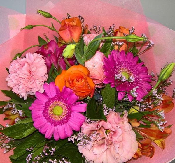 A combination of pink & orange flowers, in our beautiful  wrap and ribbon.