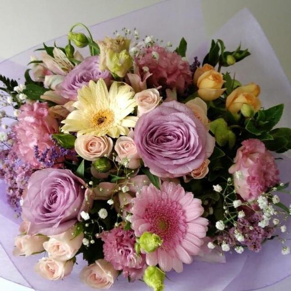 A pretty mix of soft coloured flowers