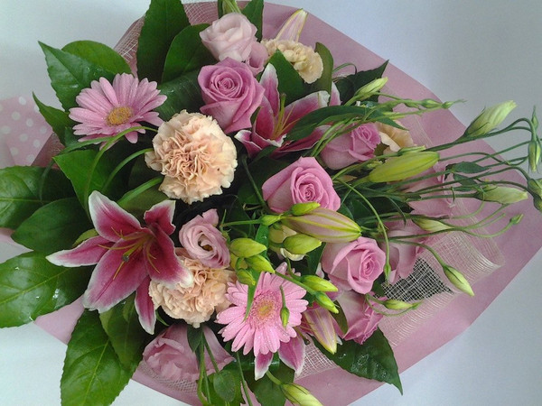 This bouquet is sure to please, with pretty pinks and wrap to compliment.