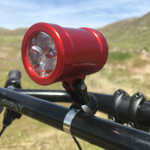 Sinewave Cycles Beacon in red, mounted to Schmidt Headlight Bracket.