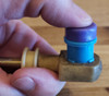 Step 2:  Place driver under thumb and bushing 'tang' or teeth edge down away from driver as shown.