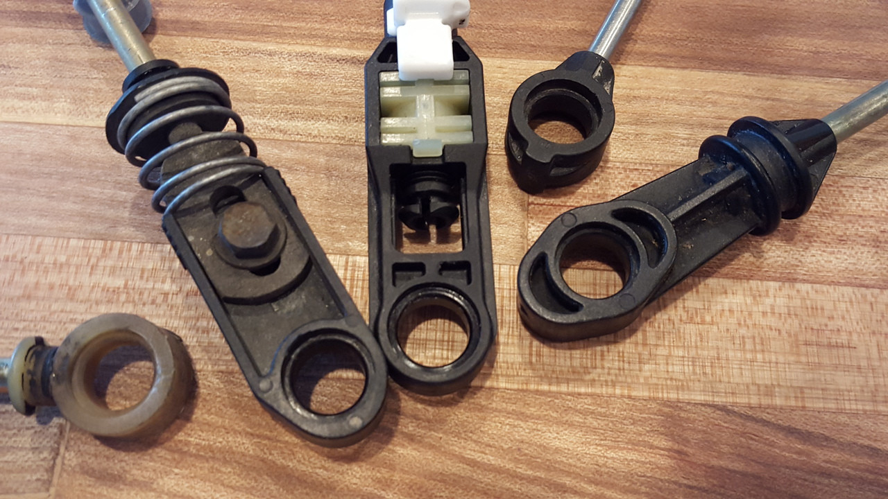 This Ford Escape kit will fit any of the shifter cable clips shown (and more)