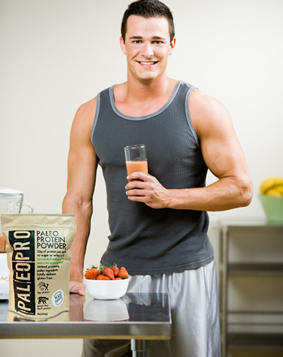 Athletic guy dressed for a work out drinking a smoothie made with PaleoPro Protein Powder with grass-fed beef.