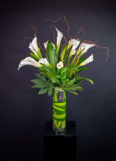 All white Calla Lily arrangement in clear glass vase.