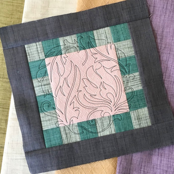 Feathered Frills Quilting