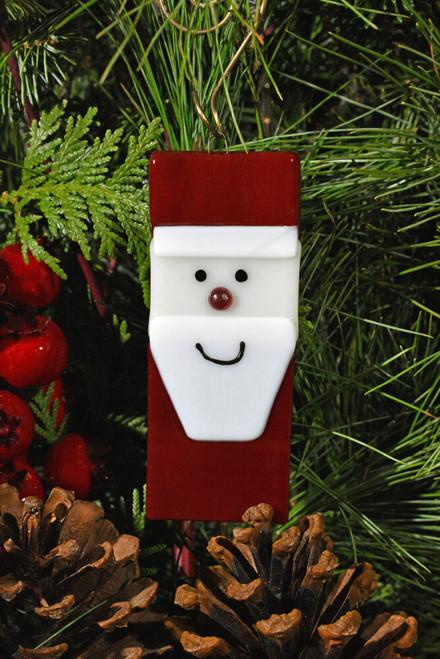 Ho! Ho! Ho! It's Jolly Santa with a red cap, white beard & happy Holiday grin.
