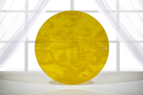 "18.5"" diameter fused art glass that has a mix of transparent marigold yellow with streaks of opaque white."