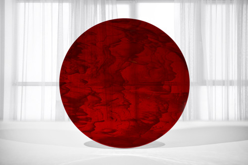 """18.5"""" diameter fused art glass that has a mix of transparent deep red with streaks of opaque white. Best near bright light or backlit."""