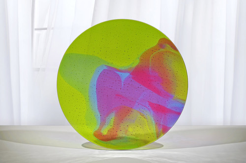 "18.5""d aurora with transparent colors of spring green, light blue and pink. One of a kind. Shallow drop. Shown standing."