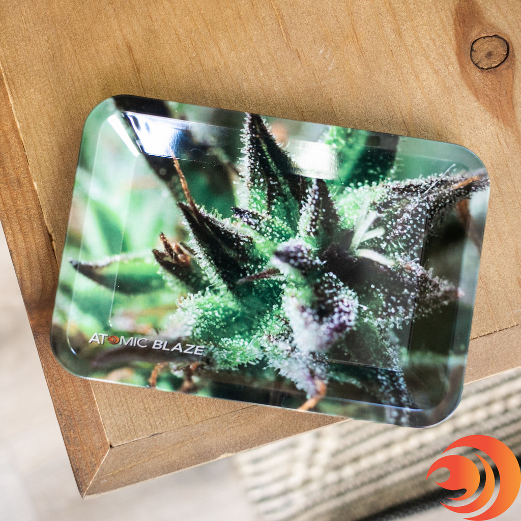 An easy-to-use rolling small metal tray with a leaf print and the Atomic Blaze online smokeshop logo for mess-free rolling.