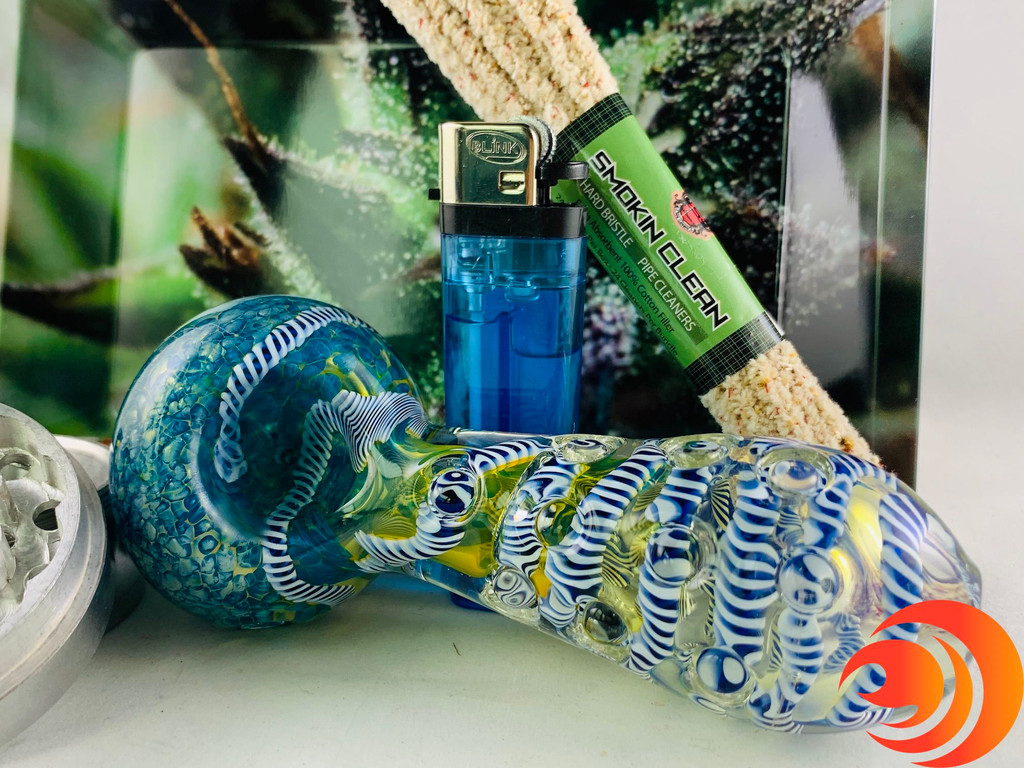This hand crafted smoke pipe has little bubbles blown throughout it with cascading colors and included as part of the smoking bundle.