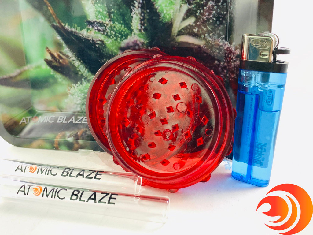 AtomicBlaze Smoke Shop Online carries smoke gift bundles like this one with glass chillums, an acrylic grinder,  blink lighter and a small metal rolling tray.