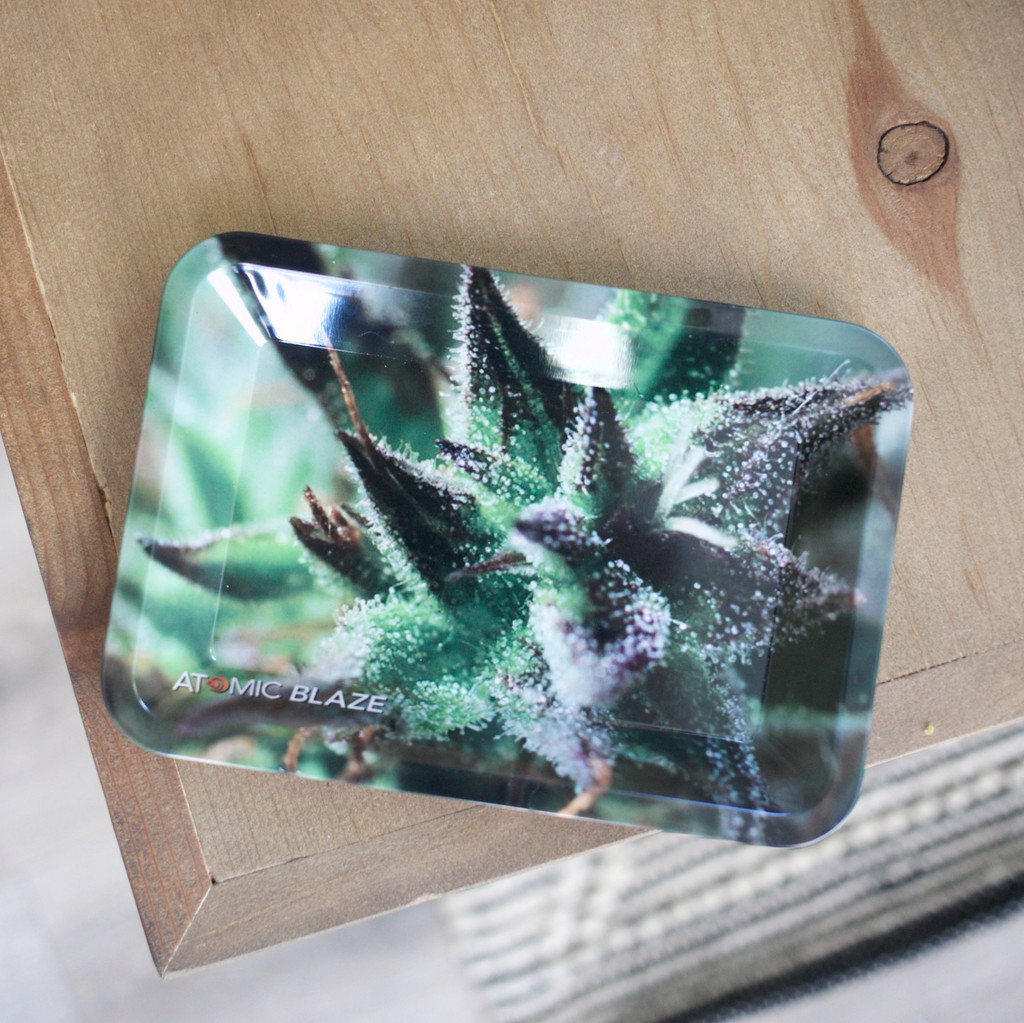 The stylish rolling tray from Atomic Blaze Head Shop in Sarasota Florida, is big enough to hold all your smoking supplies but still very handy as it can be carried along as an essential travel companion.