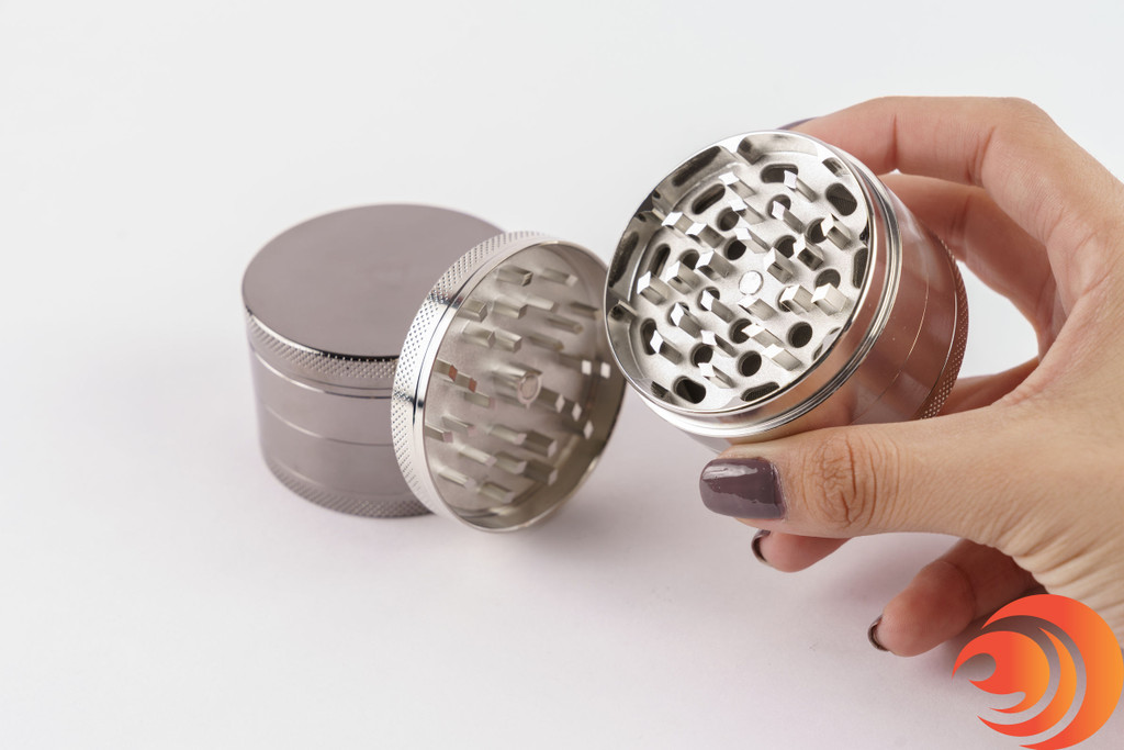 The easy grip design and ultra-sharp teeth on this metal grinder from Atomic Blaze smoke shop, make grinding super quick and effortless
