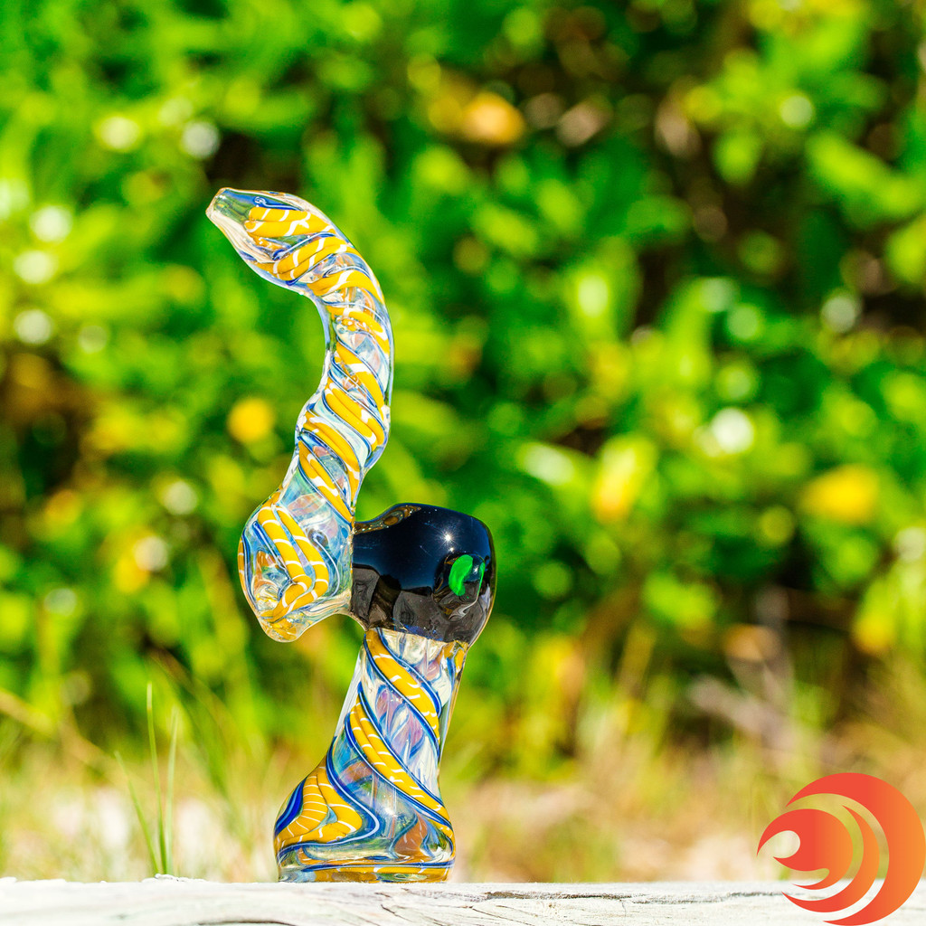 Get great rips with this blue and yellow glass bubbler pipe from the Atomic Blaze online smoke shop.