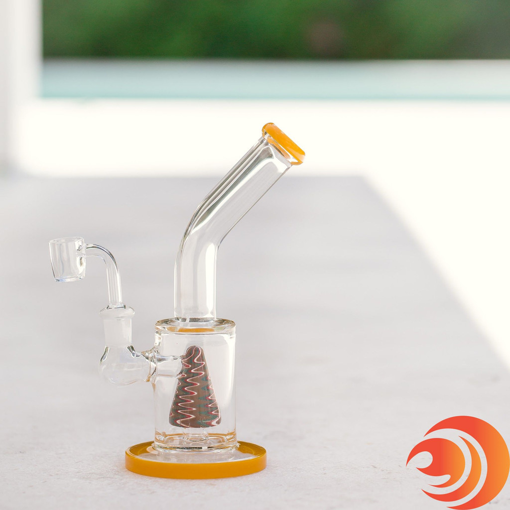 This yellow trimmed pyramid glass rig from Atomic Blaze online smoke shop is a dab rig or water bong.