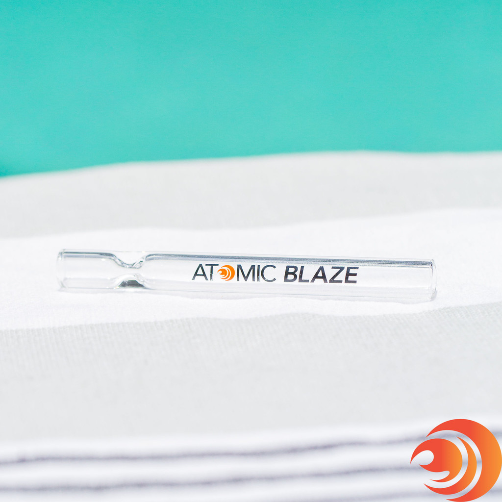 The second one-hitter glass chillum in the pack is a clear straight glass chillum with Atomic Blaze branding.