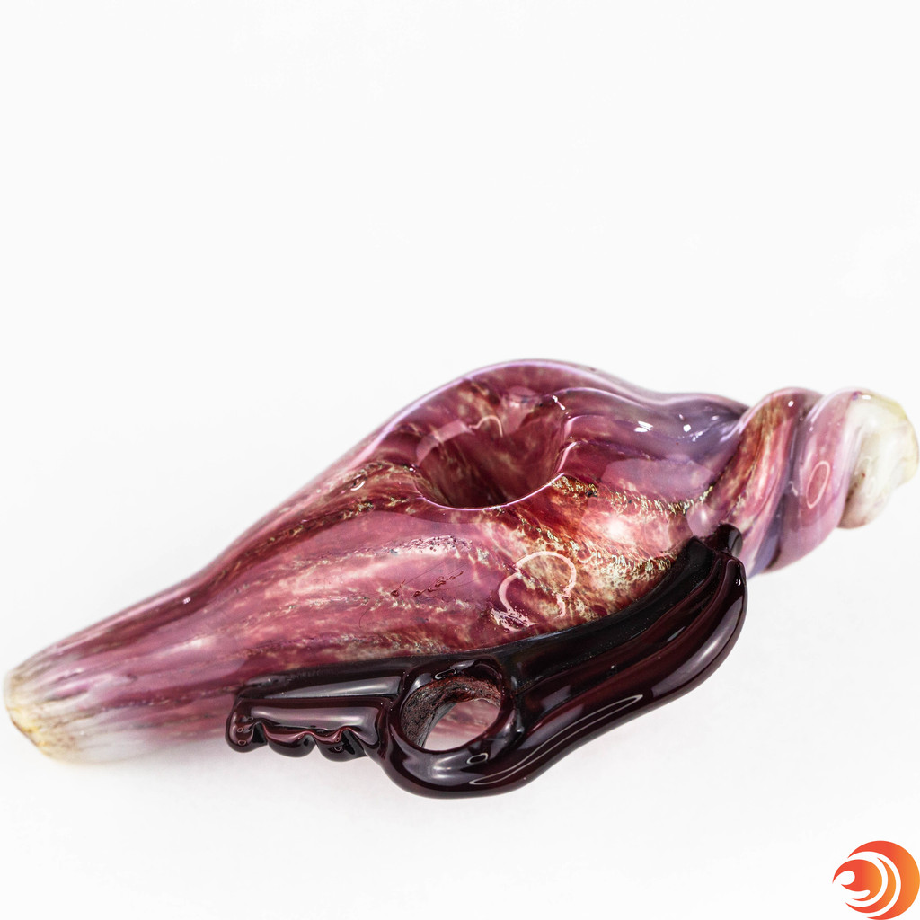 The red sea snail shell from Atomic Blaze Smoke Shop will deliver big hits with it's large chamber for smoke.